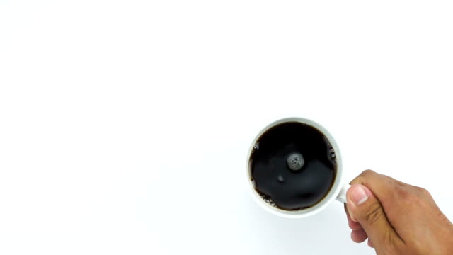 place a cup of black coffee, top view white table with hand - table top shot video stock e b–roll