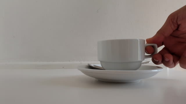place coffee cup on the saucer. - saucer stock videos & royalty-free footage