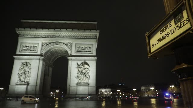 """place de l etoile"""" with the arc de triomphe pictured without any car traffic as the new curfew begins in france on january 16, 2021 in paris, france.... - triumphal arch stock videos & royalty-free footage"""