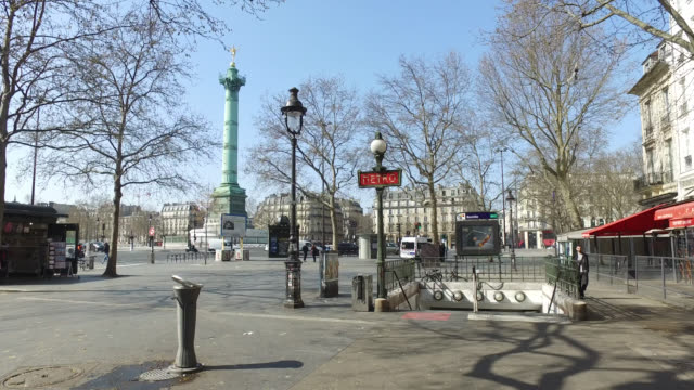 place de la bastille with very little lifethird day of confinement in francemarch 1ç 2020 in paris france parisians are adapting to life under strict... - bastille paris stock videos & royalty-free footage
