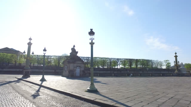 place de la concorde and start of street of rivoli with a bicycle and three pedestrians during the coronavirus epidemic on april 8 in paris france... - four people stock videos & royalty-free footage