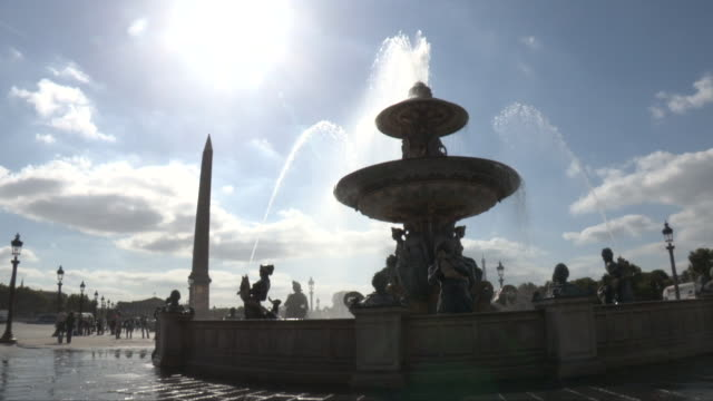 Place de la Concorde in Paris, France. View of the fountain in the sun. Large view of the Obelisk.