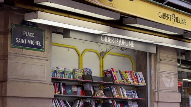stockvideo's en b-roll-footage met place saint-miche let boulevard saint michel, in paris, four bookstores bearing the gibert jeune stamp are going to close. only two others, at number... - boulevard
