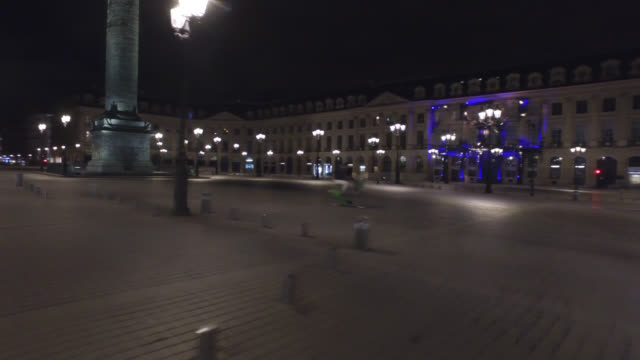 place vendome, at night, without traffic and with two people. april 30, 2020 in paris, france. - place vendome stock videos & royalty-free footage