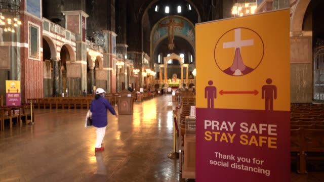 places of worship reopen in britain for individual prayer, with the catholic westminster cathedral requiring social distancing and hand sanitiser,... - hand stock videos & royalty-free footage