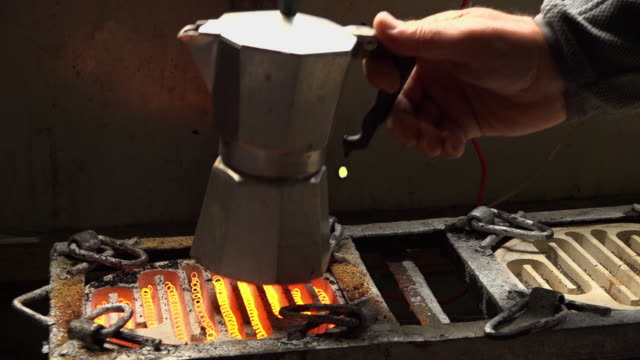 placing a coffee pot on a red hot coil stove - boiling stock videos & royalty-free footage