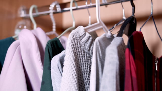placing clothing into the closet - wardrobe stock videos & royalty-free footage