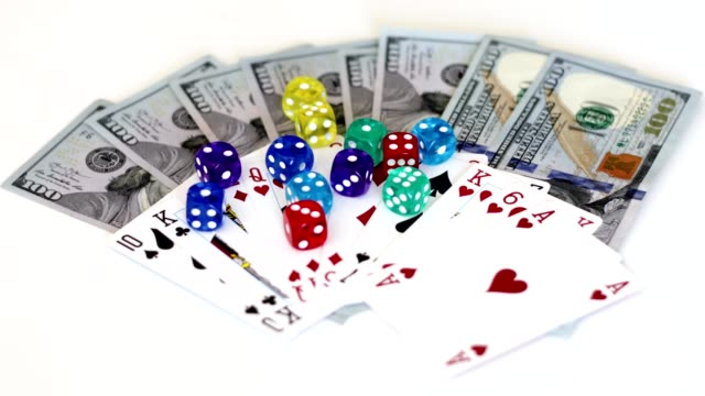 placing gambling dice on game cards and paper money - hand of cards stock videos & royalty-free footage