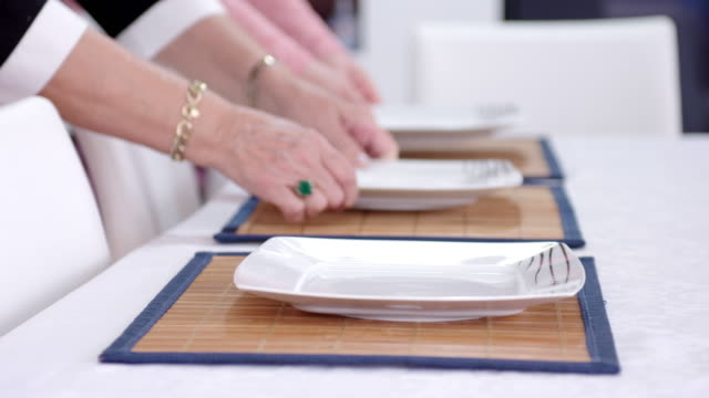 Placing plates on the dining table