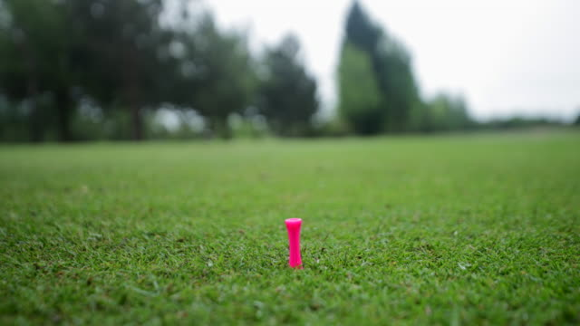 placing the golf ball - green golf course stock videos & royalty-free footage