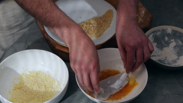 plaice fillet breading. - flounder stock videos & royalty-free footage
