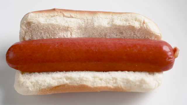 plain hot dog on white background - single object stock videos & royalty-free footage