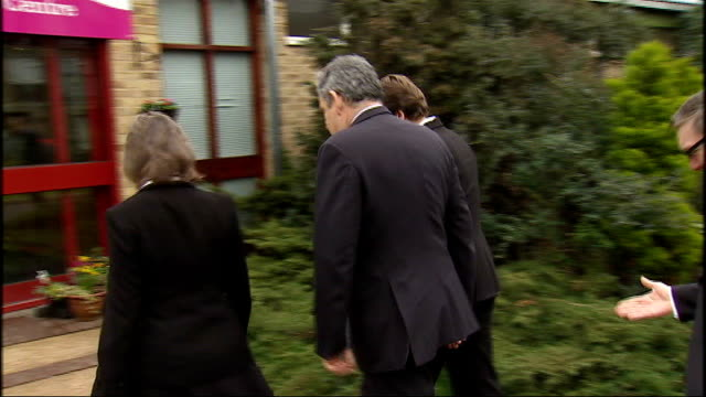 gordon brown mp along as shakes hands with community resource centre staff then into building london: int david cameron mp press conference sot - how... - 改革論者点の映像素材/bロール