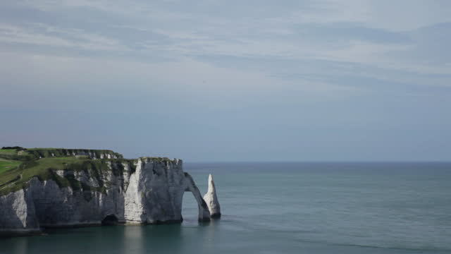 plan large cliff of etretat in normandy - france blue sky - allied forces stock videos & royalty-free footage