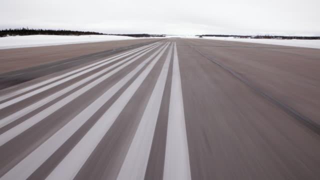 POV of plan moving forward on airstrip
