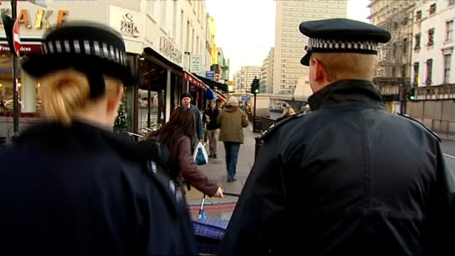 stockvideo's en b-roll-footage met plan to make police recruits work for free criticised ext two police constables away down street - rekruut