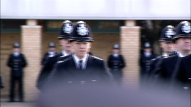 stockvideo's en b-roll-footage met plan to make police recruits work for free criticised lib police cadets lined up on parade ground - rekruut