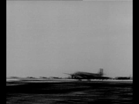 plane arrives on runway / british foreign secretary anthony eden walks talks with soviet foreign minister vyacheslav molotov upon eden's arrival at... - vyacheslav m. molotov stock videos and b-roll footage