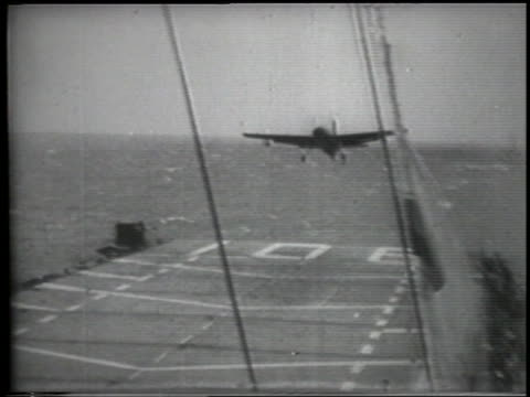 plane attempting landing on aircraft carrier crashes into ocean - landefahrwerk stock-videos und b-roll-filmmaterial