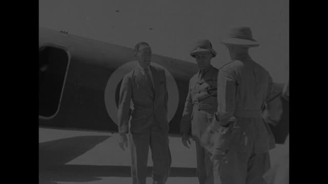 plane carrying british envoy stafford cripps taxis at airfield / cripps steps out of plane he is greeted by officials and shakes their hands / he... - linlithgow stock videos and b-roll footage