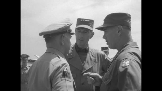 plane carrying gen. mark w. clark and wife maurine taxiing at airfield / clark shaking hands with officers at bottom of steps to plane, maurine... - vangen stock-videos und b-roll-filmmaterial