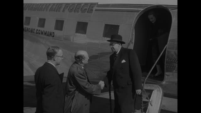Plane carrying Paul Martin Canadian Minister of National Health and Welfare taxis at airport / Martin comes down steps of plane he is greeted by Val...