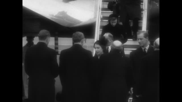 plane carrying queen elizabeth taxis towards camera / prime minister winston churchill looks on with group of waiting dignitaries / elizabeth and... - george vi of the united kingdom stock videos & royalty-free footage
