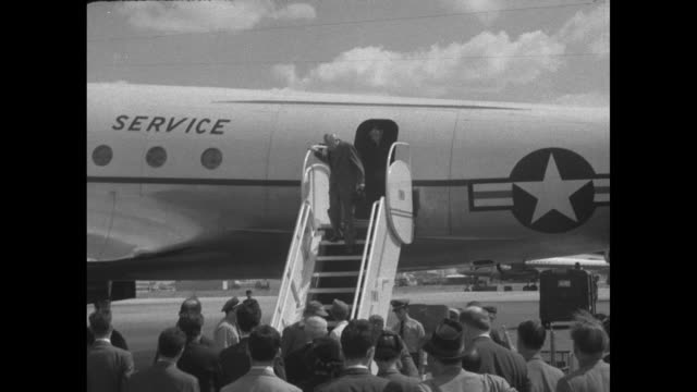 plane carrying us secretary of state john foster dulles taxis at paris airport / dulles walks down steps of plane / he is greeted by officials / he... - awning stock videos & royalty-free footage