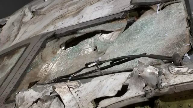 plane crash caused by russian buk missile, prosecutors allege; lib gilze-rijen: int general views sections of mangled plane wreckage - ukraine stock videos & royalty-free footage
