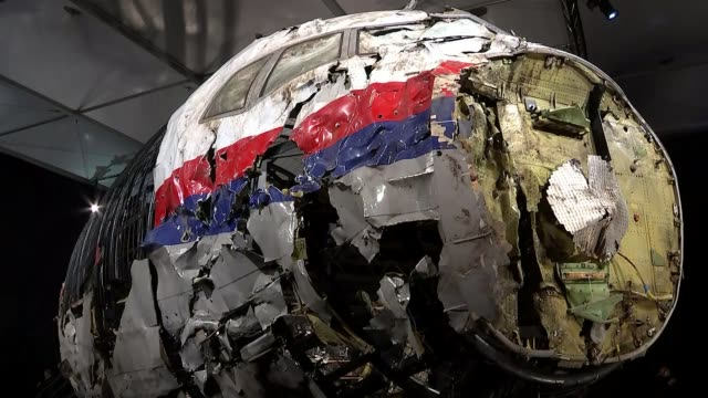 plane crash report blames missile; gilze-rijen airbase: int gvs of reconstructed wreckage of malaysian airlines boeing 777 plane which was shot down... - ukraine stock videos & royalty-free footage