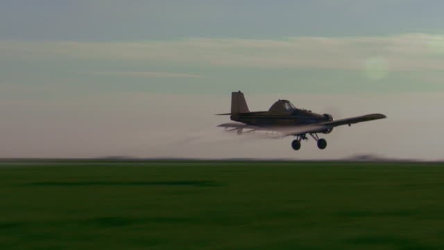 plane crop dusting very low, handheld - insecticide stock videos & royalty-free footage