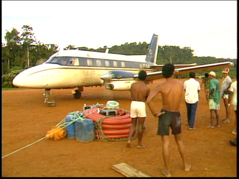 a plane delivers supplies to an amazon gold mine - roraima state stock videos and b-roll footage