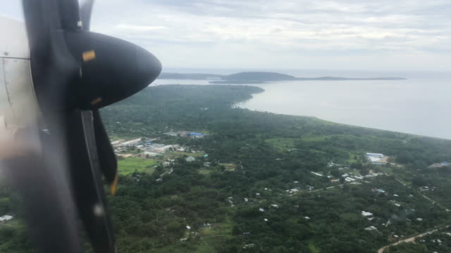 plane descends on december 6, 2019 into port vila, vanuatu. 25 percent of vanuatu's 276,000 citizens lost their homes in 2015 when cyclone pam, a... - pacific ocean stock videos & royalty-free footage