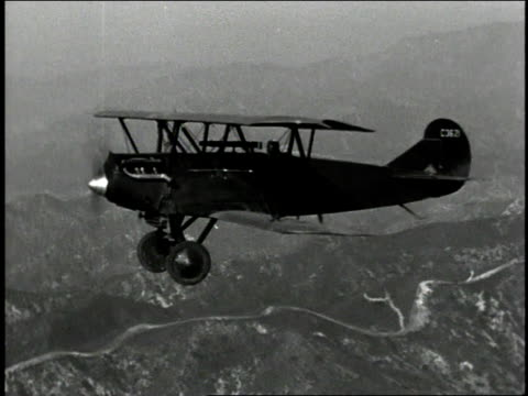 aerial plane dipping up and down - 1940 video stock e b–roll
