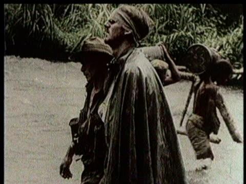 plane drops supplies / narrated / world war 2 / troops march through a village / troops march through the jungle / troops march through mud /... - narrating stock-videos und b-roll-filmmaterial