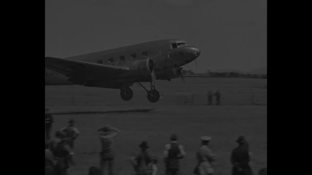 plane flown by dutch pilots k d parmentier and j j moll lands on airfield near melbourne / two shots of plane taxiing - 1934 bildbanksvideor och videomaterial från bakom kulisserna