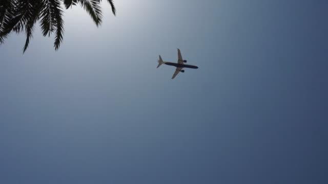 plane flying across spanish sky - majorca stock videos & royalty-free footage