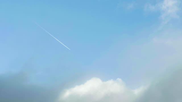 plane flying across the blue sky - clear sky stock videos & royalty-free footage