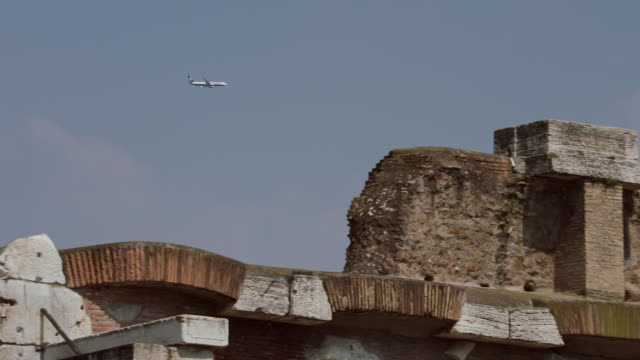 MS PAN Plane flying in sky over ancient ruin / Rome, Italy