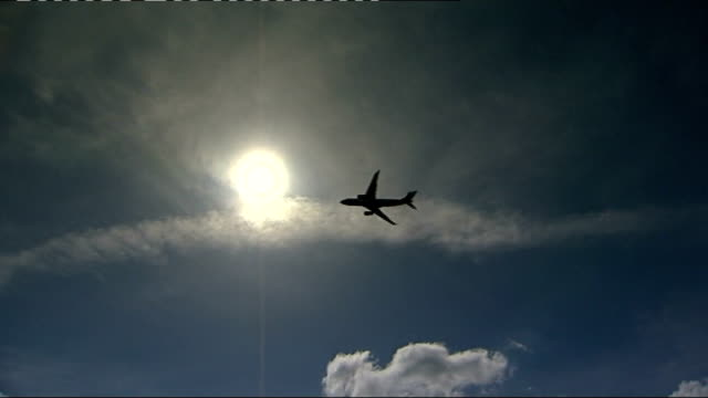 plane flying in sky - ash stock videos & royalty-free footage