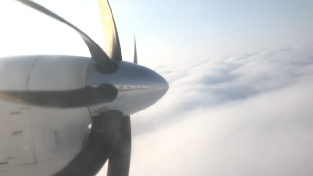 plane flying into clouds in alaska - propeller stock videos & royalty-free footage