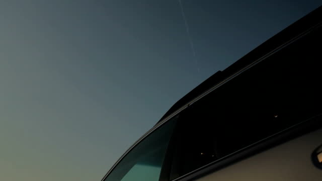 Plane Flying over a parked car