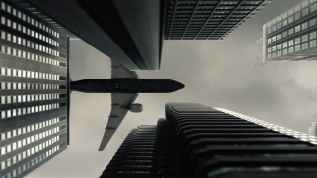 plane flying over the city - airplane crash stock videos and b-roll footage