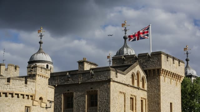 a plane flying over the tower of london, london, uk. - tower of london stock videos & royalty-free footage