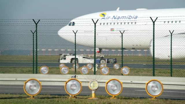 plane is towed to the taxiway on airport, frankfurt am main, hesse, germany - taxiway stock-videos und b-roll-filmmaterial