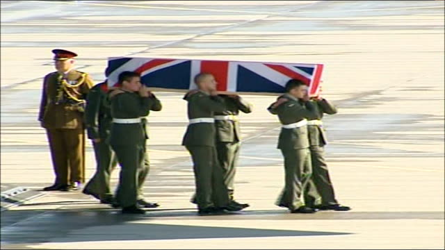 plane landing carrying bodies of fourteen british soldiers/ prince philip arrival military pallbearers marching from plane carrying coffin draped in... - hearse stock videos & royalty-free footage
