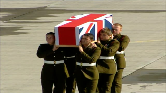 plane landing carrying bodies of fourteen british soldiers/ prince philip arrival various views of pallbearers along with coffin resting on shoulders... - hearse stock videos & royalty-free footage