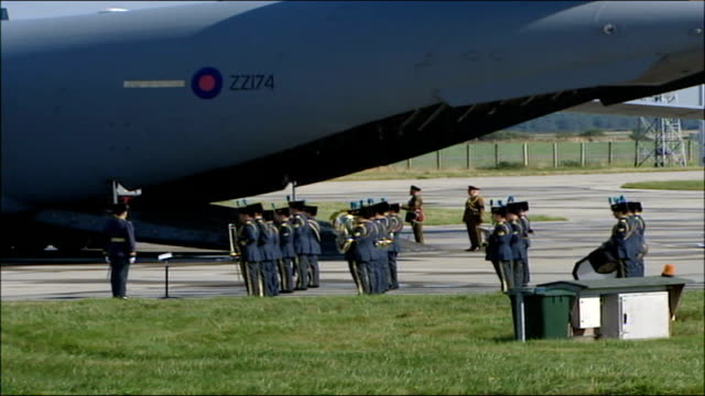 plane landing carrying bodies of fourteen british soldiers/ prince philip arrival military band soldiers standing in rows next c17 plane / bearer... - hearse stock videos & royalty-free footage