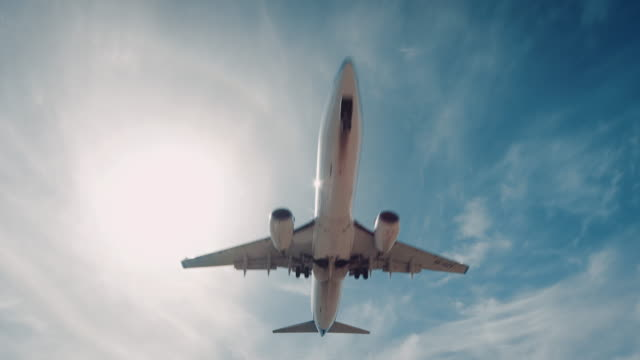 plane landing on airport - mid air stock videos & royalty-free footage