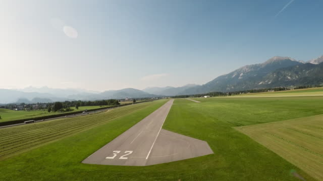 pov plane landing on the airstrip in sunshine - runway stock videos & royalty-free footage